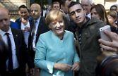 Merkel selfie with a landed refugee in Germany, in '15