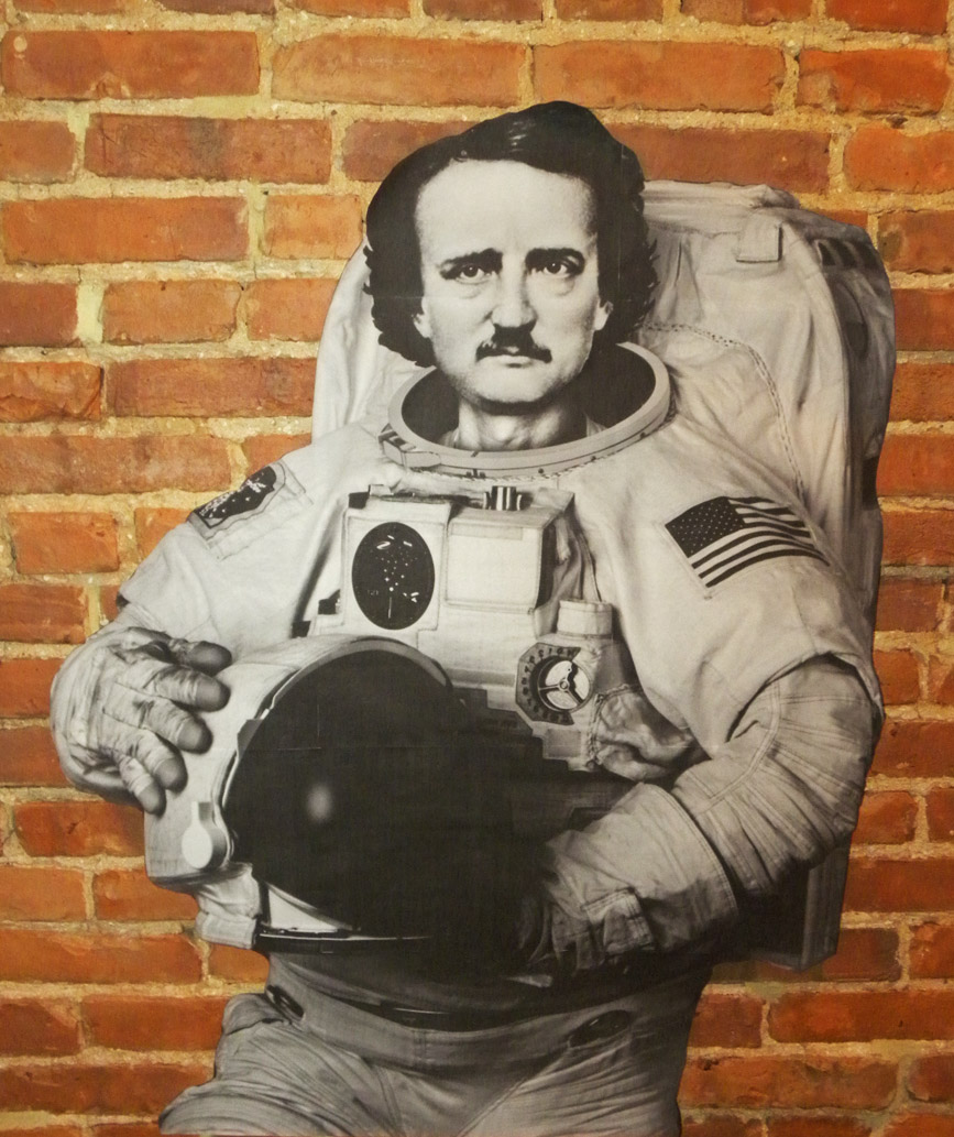 This is a Edgar Allan Poestronaut wheatpaste by the artist TOVEN in Baltimore near Poe's gravesite.