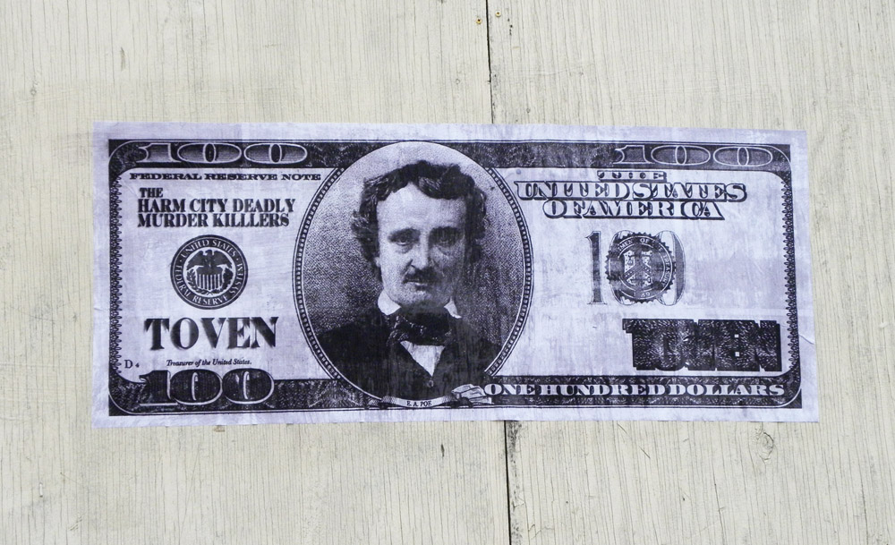 "This is a wheatpaste of Edgar Allan Poe on a one hundred dollar bill, ""Poe Dough"", by the Baltimore street artist TOVEN.  You can see more of TOVEN's work here - http://www.flickr.com/photos/65757968@N00/"