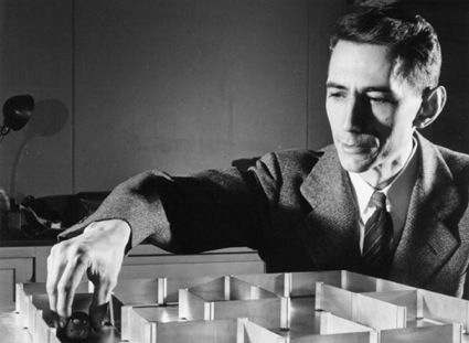 Claude Shannon with mouse in maze